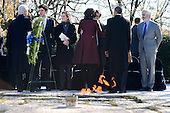 Former United States President Bill Clinton, First Lady Michelle Obama and U.S. President Barack Obama speak to Jack Schlossberg, son of U.S. Ambassador to Japan Caroline Kennedy and grandson of President Kennedy, and other members of the Kennedy family after laying a wreath at the gravesite for President John F. Kennedy at Arlington National Cemetery in Arlington, Virginia, November 20, 2013. This Friday will mark the 50th anniversary of the assassination of President Kennedy. <br /> Credit: Pat Benic / Pool via CNP