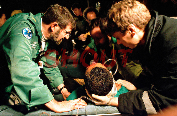 Paramedic, firefighters and police officers attend a RTA in which the driver remains trapped. They have placed an oxygen mask and a neck brace on the victim. This image may only be used to portray the subject in a positive manner..©shoutpictures.com..john@shoutpictures.com