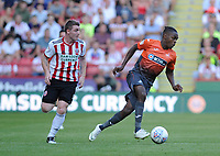 Sheffield United's John Fleck battles with Swansea City's Joel Asoro during the Sky Bet Championship match between Sheffield United and Swansea City at Bramall Lane, Sheffield, England, UK. Saturday 04 August 2018