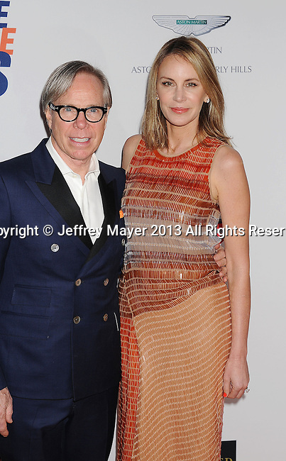 CENTURY CITY, CA- MAY 03: Designer Tommy Hilfiger and Dee Ocleppo Hilfiger arrive at the 20th Annual Race To Erase MS Gala 'Love To Erase MS' at the Hyatt Regency Century Plaza on May 3, 2013 in Century City, California.