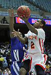 Winston-Salem Prep's Mike Hughes (2) drives against Plymouth's Davonte Spruill during the Phoenix' 61-49 win in the State Championship at the Dean Smith Center in Chapel Hill, NC, on Saturday, March 10, 2012.  Photo by Ted Richardson