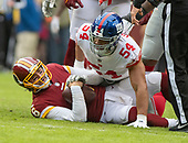 Washington Redskins quarterback Mark Sanchez (6) clutches the ball as he lies on the ground after being sacked in the first qurarter by New York Giants outside linebacker Olivier Vernon (54) of the game at FedEx Field in Landover, Maryland on Sunday, December 9, 2018.<br /> Credit: Ron Sachs / CNP<br /> (RESTRICTION: NO New York or New Jersey Newspapers or newspapers within a 75 mile radius of New York City)