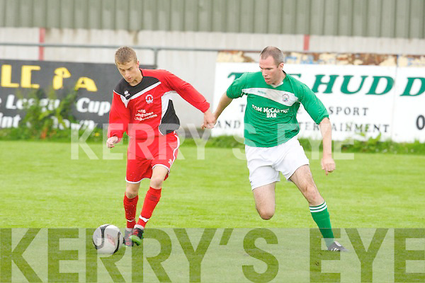 St Brendan's Park's David Courtney gets away from Castleisland FC's Mike K McCarthy in action in the Castle Bar Cup Final at Mounthawk park, Tralee on Sunday.