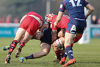 Jason Harries of London Scottish is tackled during the Greene King IPA Championship match between London Scottish Football Club and Jersey at Richmond Athletic Ground, Richmond, United Kingdom on 18 February 2017. Photo by David Horn / PRiME Media Images.