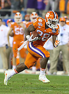 Charlotte, NC - December 2, 2017: Clemson Tigers running back Tavien Feaster (28) runs the ball during the ACC championship game between Miami and Clemson at Bank of America Stadium in Charlotte, NC. Clemson defeated Miami 38-3 for their third consecutive championship title. (Photo by Elliott Brown/Media Images International)