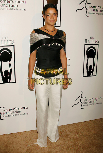 "MICHELLE RODRIGUEZ.Women's Sports Foundation Presents ""The Billies"" Gala held at the Beverly Hilton, Beverly Hills, California, USA..April 11th, 2007 .full length white trousers black top belt gold elephants wrap shawl.CAP/ADM/RE.©Russ Elliot/AdMedia/Capital Pictures"