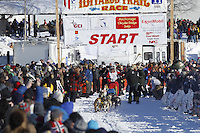 Wattie McDonald leaves the start chute in Willow, Alaska duirng the re-start of the 2011 Iditarod.