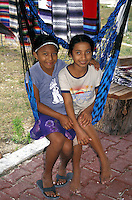 Young Maya girls sitting in a hammock,  Puerto Morelos, Quintana Roo, Mexico