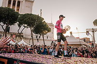 """Maglia Rosa / overall winner Chris Froome (GBR/SKY) walking off the final podium in Rome  with the enigmatic 'Trofeo Senza Fine' (""""Never Ending Trophy"""")<br /> <br /> stage 21: Roma - Roma (115km)<br /> 101th Giro d'Italia 2018"""