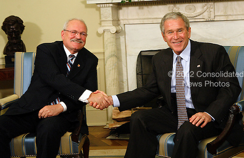 United States President George W. Bush meets with the President of the Slovak Republic, Ivan Gasparovic in the Oval Office of the White House, in Washington DC, on October 09, 2008.<br /> Credit: Aude Guerrucci / Pool via CNP