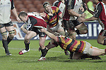 Nigel Watson tries to break out of a tackle during the Air NZ Cup week 5 game between Waikato & Counties Manukau played at Rugby Park, Hamilton on 26th of August 2006.