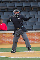 Home plate umpire David Pritchett calls a batter out on strikes during the NCAA baseball game between the Georgetown Hoyas and the Wake Forest Demon Deacons at Wake Forest Baseball Park on February 16, 2014 in Winston-Salem, North Carolina.  The Demon Deacons defeated the Hoyas 3-2.  (Brian Westerholt/Four Seam Images)