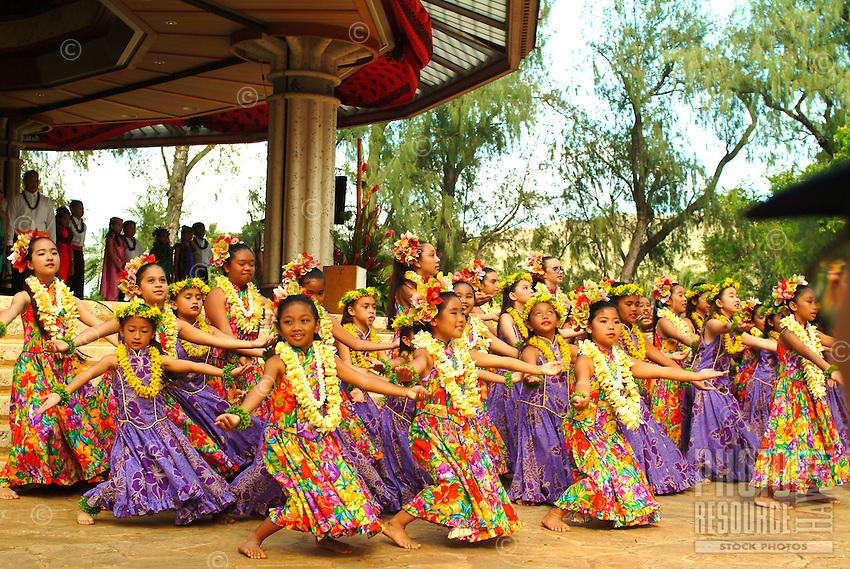 Keiki hula dancers from Halau Hula O Hokulani dancing at the Kapiolani park on Lei Day.