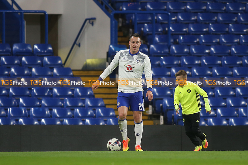 Chelsea's John Terry enjoyed some family time after the final whistle as he played football on the pitch with his son, Georgie, during Chelsea vs Manchester United, Emirates FA Cup Football at Stamford Bridge on 13th March 2017