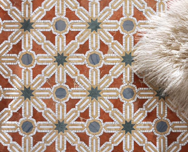 Alcazar, a waterjet and hand-cut stone mosaic, shown in polished Calacatta, Spring Green, Blue Macauba, Rojo Alicante and Renaissance Bronze, is part of the Miraflores collection by Paul Schatz for New Ravenna.