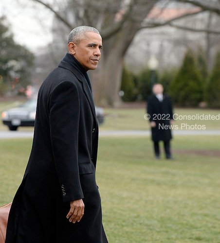 United States President Barack Obama walks on the South Lawn toward marine One to depart the White House ,  January 10, 2017 in Washington, DC. The President is traveling to Chicago to deliver his farewell address to the American people. <br /> Credit: Olivier Douliery / Pool via CNP