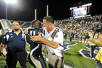 27 November 2010:  FIU Football Head Coach Mario Cristobal embraces Ashlyn Parker (11) in celebration after the FIU Golden Panthers defeated the Arkansas State Red Wolves, 31-24, at FIU Stadium in Miami, Florida.  With the victory, FIU won the Sun Belt Conference championship and became bowl eligible for the first time in the school's history.