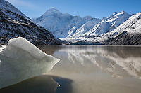 Aoraki Mt Cook with small Iceberg in foreground.  Hooker Lake, South Island New Zealand.