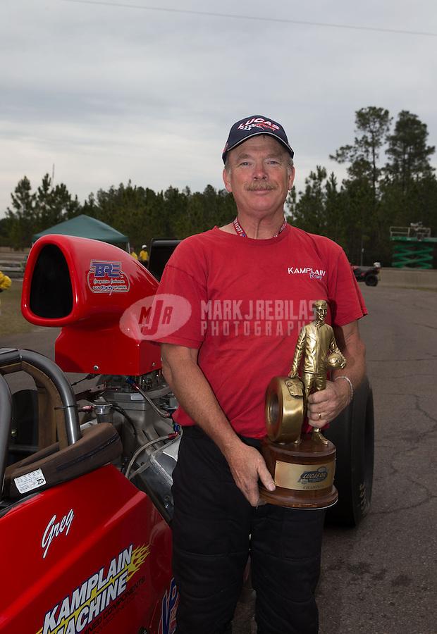 Mar. 17, 2013; Gainesville, FL, USA; NHRA super comp driver Greg Kamplain celebrates after winning the Gatornationals at Auto-Plus Raceway at Gainesville. Mandatory Credit: Mark J. Rebilas-