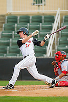 Kyle Robinson (28) of the Kannapolis Intimidators follows through on his swing against the Hagerstown Suns at CMC-Northeast Stadium on May 16, 2013 in Kannapolis, North Carolina.  The Suns defeated the Intimidators 10-7.   (Brian Westerholt/Four Seam Images)