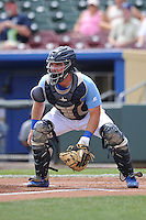 Omaha Storm Chasers catcher Zane Evans (28) waits for throw to home plate during the game against the El Paso Chihuahuas at Werner Park on May 30, 2016 in Omaha, Nebraska.  El Paso won 12-0.  (Dennis Hubbard/Four Seam Images)