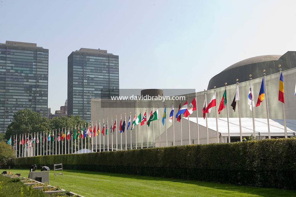 8 September 2005 - New York City, NY - Member state flags fly in front of the United Nations headquarters in New York, USA, 8 September 2005, for the first time since early this year. Construction work prevented the flags from being hoisted. The 4 by 6 feet flags are placed in English alphabetical order, from Afghanistan, at 48th Street, to Zimbabwe, by 42nd Street. They come down every day at 4pm and are stored in small boxes at the base of the poles. Photo Credit: David Brabyn