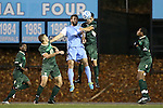 21 November 2013: North Carolina's Jonathan Campbell (2) and USF's Samuel Hosseini (GER) (right) challenge for a header. The University of North Carolina Tar Heels hosted the University of South Florida Bulls at Fetzer Field in Chapel Hill, NC in a 2013 NCAA Division I Men's Soccer Tournament First Round match. North Carolina won the game 1-0.