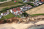 A 12-bedroom guesthouse under threat. The Happisburgh cliffs are eroding at a rate of approximately twelve metres a year. Since 1990 over 25 properties have been lost to the sea due to global warming. Happiburgh's timber revetments were constructed in 1959 as part of a series of protection measures. Various schemes were proposed throughout the 1990s but for a variety of reasons eash failed to reach fruition.
