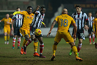 Akwasi Asante and Sam Jones of Grimsby battle against Mitch Rose and David Pipe of Newport County during the Sky Bet League 2 match between Newport County and Grimsby Town at Rodney Parade, Newport, Wales on 14 February 2017. Photo by Mark  Hawkins / PRiME Media Images.