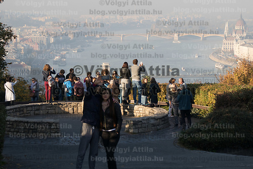 Tourists take pictures of the foggy autumn view in Budapest, Hungary on Oct. 20, 2017. ATTILA VOLGYI