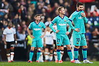 25th January 2020; Mestalla, Valencia, Spain; La Liga Football,Valencia versus Barcelona; Lionel Messi of FCB and his team mates react after the second goal for Valencia scored by Maxi Gomez of Valencia CF for 2-0 in minute 77
