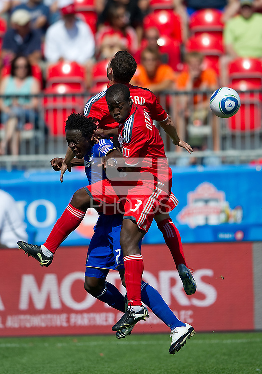 05 June 2010: Kansas City Wizards forward Kei Kamara #23 collides with Toronto FC defender Nana Attakora #3 and Toronto FC defender Dan Gargan #8  during a game between the Kansas City Wizards and Toronto FC at BMO Field in Toronto..The game ended in a 0-0 draw.