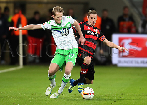 01.04.2016. Leverkusen, Germay. Bundesliga football. Bayer Leverkusen versus VFL Wolfsburg in the BayArena in Leverkusen.  Andre Schuerrle (Wolfsburg) and Lars Bender (Leverkusen).