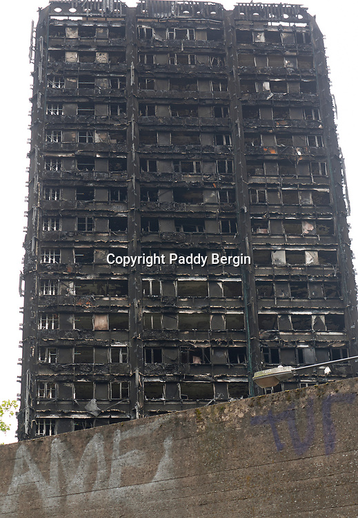 The Grenfell Tower fire occurred on 14 June 2017 at the 24-storey, 220-foot-high (67 m), Grenfell Tower block of public housing flats in North Kensington, Royal Borough of Kensington and Chelsea, West London. It caused at least 80 deaths and over 70 injuries. A definitive death toll is not expected until at least 2018. <br /> <br /> As of 20 July 2017, 40 victims had been formally identified by the Metropolitan Police and Coroner, including a stillborn baby. Authorities were unable to trace any surviving occupants for 23 of the 129 flats and they are believed to have died in the fire. About 255 people survived.<br /> <br /> The fire started in a fridge-freezer on the fourth floor. The growth of the fire is believed to have been accelerated by the building's exterior cladding.<br /> <br /> Emergency services received the first report of the fire at 00:54 local time. It burned for about 60 hours until finally extinguished. More than 250 firefighters and 70 fire engines from stations all over London were involved in efforts to control the fire. Many firefighters continued to fight pockets of fire on the higher floors after most of the rest of the building had been gutted. Residents of surrounding buildings were evacuated due to concerns that the tower could collapse, but the building was later determined to be structurally sound.<br /> <br /> Firefighters rescued 65 people. Seventy-four people were confirmed to be in six hospitals across London, and 17 of them were in a critical condition.<br /> <br /> Stock Photo by Paddy Bergin