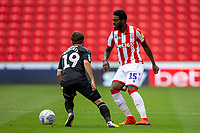 27th June 2020; Bet365 Stadium, Stoke, Staffordshire, England; English Championship Football, Stoke City versus Middlesbrough; Bruno Martins Indi of Stoke City under pressure from Patrick Roberts of Middlesbrough