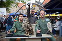 """Edinburgh, UK. 09.08.2016. Cast members, Lewis Howard (as Callum), Alan Munden, and  Ben Dyson (as Paddy) from """"Swivelhead"""", Pipeline Theatre's new play, meet a barn owl and an eagle owl in the courtyard at the Pleasance. """"Swivelhead"""" runs from 3rd - 29th August in Peasance 2. Photograph © Jane Hobson."""