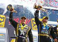 Sep 5, 2016; Clermont, IN, USA; NHRA top fuel driver Tony Schumacher (left) celebrates alongside teammate funny car driver Matt Hagan after winning the US Nationals at Lucas Oil Raceway. Mandatory Credit: Mark J. Rebilas-USA TODAY Sports