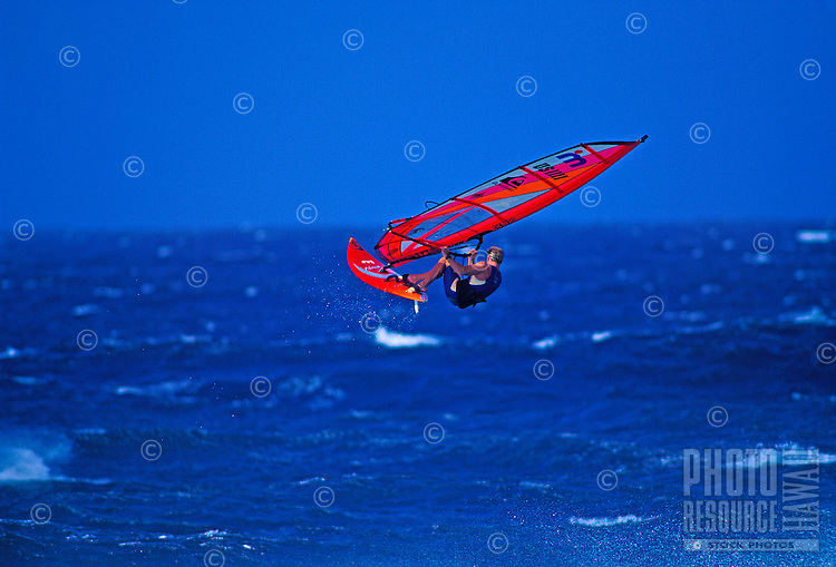 A windsurfer takes to the air at Maui's Hookipa Beach.