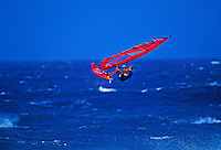 A windsurfer takes to the air at Maui's Hookipa Beach.