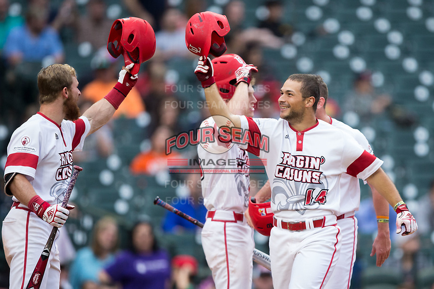 Kennon Fontenot (14) of the Louisiana Ragin' Cajuns taps helmets with teammate Daniel Lahare (26) after hitting a home run against the Vanderbilt Commodores in game five of the 2018 Shriners Hospitals for Children College Classic at Minute Maid Park on March 3, 2018 in Houston, Texas.  The Rajin' Cajuns defeated the Commodores 3-0.  (Brian Westerholt/Four Seam Images)