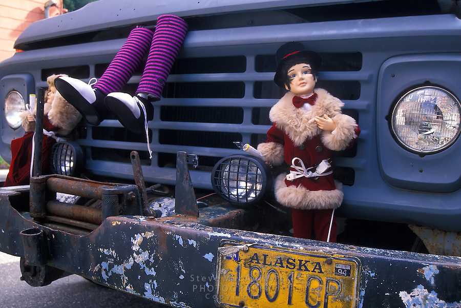 Creative decorations on front bumper of old beat-up primer painted truck,  Juneau, Alaska