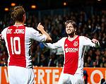 Nederland, Almelo, 20 oktober 2012.Eredivisie.Seizoen 2012-2013.Heracles Almelo-Ajax.Lasse Schone van Ajax juicht nadat hij een doelpunt heeft gemaakt. Links Siem de Jong, aanvoerder van Ajax