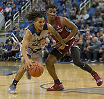 Nevada guard Jazz Johnson (22) drives against Little Rock in the second half of an NCAA college basketball game in Reno, Nev., Friday, Nov. 16, 2018. (AP Photo/Tom R. Smedes)