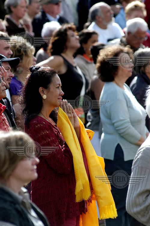 Supporters listen to His Holiness the Dalai Lama addressing the public from the stupa at the Vajradhara Ling Buddhist Temple during the visit of His Holiness to France. The Dalai Lama blessed a project to build a Temple for Peace at the centre and gave a speech to hundreds of guests.
