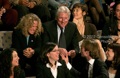 Washington, D.C. - January 4, 2007 --  Singer Carole King, left, actor Richard Gere, center, and his wife, Carey Lowell, watch from the gallery with members of the Pelosi family as as United States Representative Nancy Pelosi (Democrat of the 8th District of California) is sworn-in as the Speaker of the United States House of Representatives in the Capitol in Washington, D.C. on Thursday, January 4, 2007.  Speaker Pelosi is the first woman in U.S. history to serve in that position..Credit: Ron Sachs / CNP