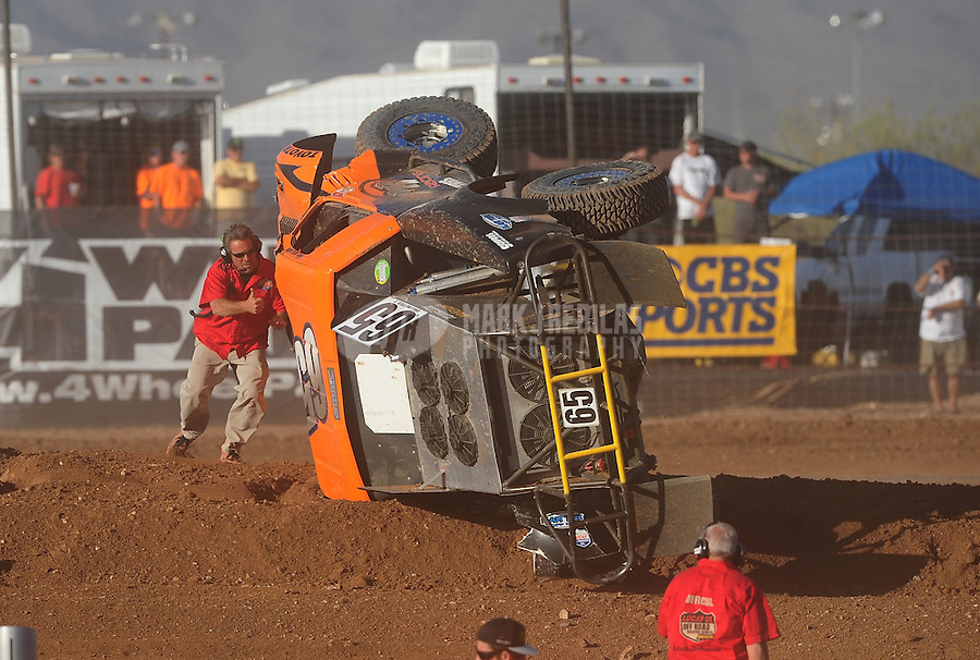 Apr 17, 2011; Surprise, AZ USA; LOORRS official checks on driver Phil Bollman (65) after flipping over during round 4 at Speedworld Off Road Park. Mandatory Credit: Mark J. Rebilas-
