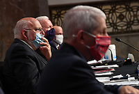 CDC Director Dr. Robert Redfield wears a face mask while testifying before the US Senate Health, Education, Labor and Pensions (HELP) Committee on Capitol Hill in Washington DC on Tuesday, June 30, 2020.  Fauci and other government health officials updated the Senate on how to safely get back to school and the workplace during the COVID-19 pandemic. <br /> Credit: Kevin Dietsch / Pool via CNP /MediaPunch