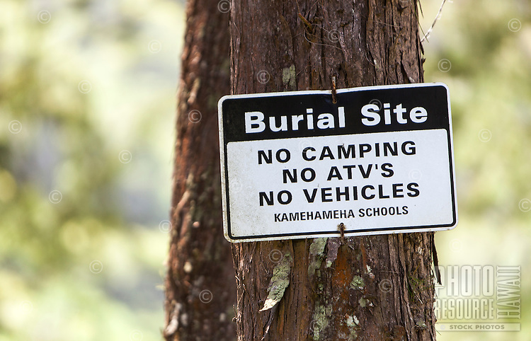 """Burial Site, No Camping, No ATV''s, No Vehicles"" sign posted on tree in Waipi'o Valley, Big Island."