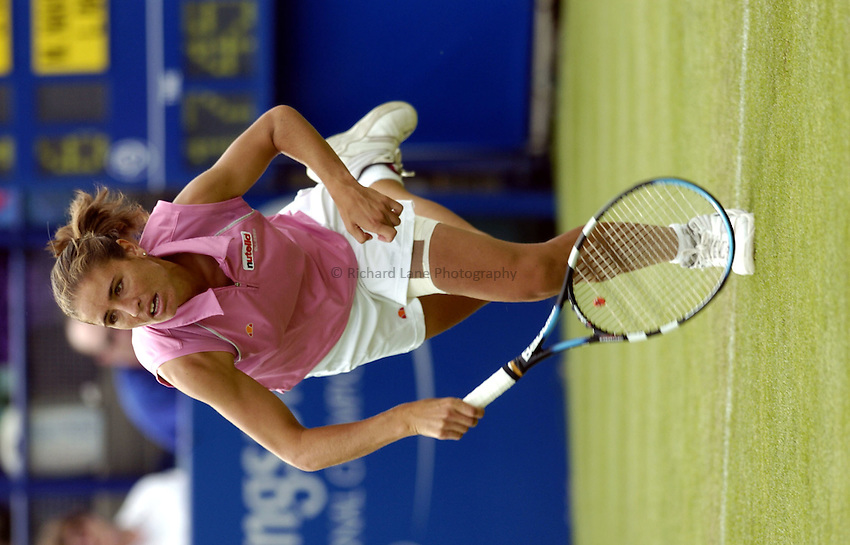 Photo: Richard Lane..Hastings Direct International Championship at Eastbourne. 15/06/2004..Rita Grande serves in a doubles match.