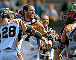 24 August 2008: Rochester Rattlers' Midfielder Colin Doyle celebrates the win over the Denver Outlaws with teammates at the Championship Game of the Major League Lacrosse Championship Weekend at Harvard Stadium in Boston, MA. The Rattles took control of the second half and outscored the Outlaws 16-6 to take the league honor for the 2008 season...Mandatory Photo Credit: Ed Wolfstein Photo